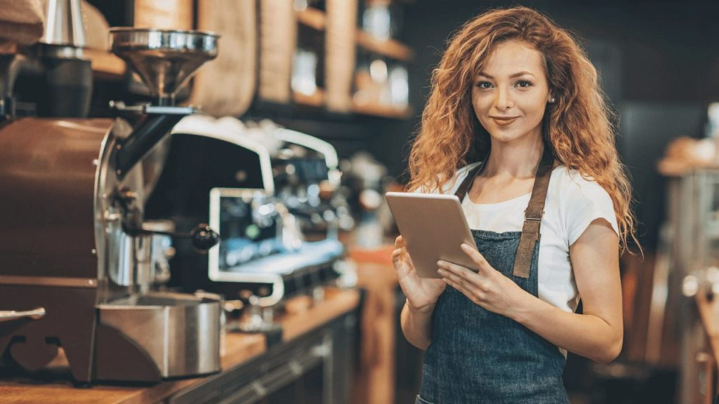 coffee shop employee using kiosk mode on android tablet for taking orders