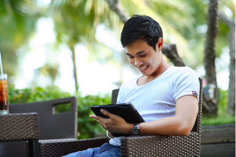 young man using mobile tablets