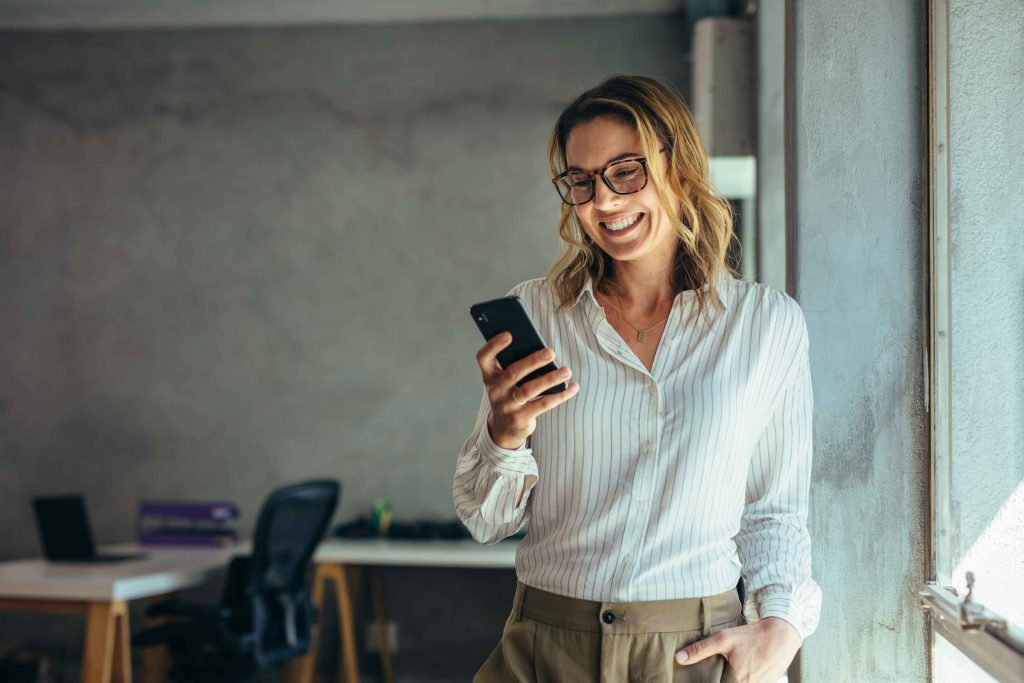 woman using smartphone in the office